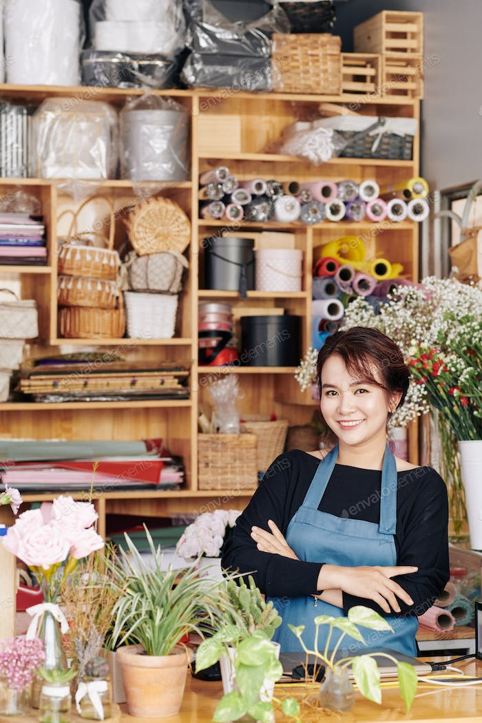 Woman enjoying working at flower shop
