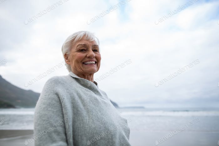 Portrait of senior woman standing on the beach