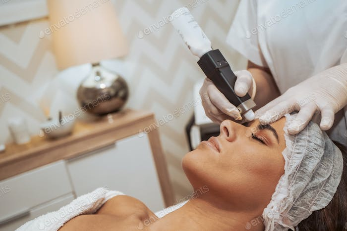 Woman doing cosmetic treatments