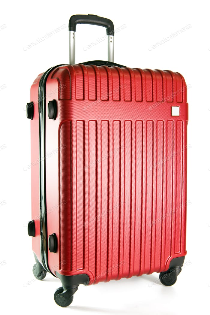 Red travel luggage isolated on white background