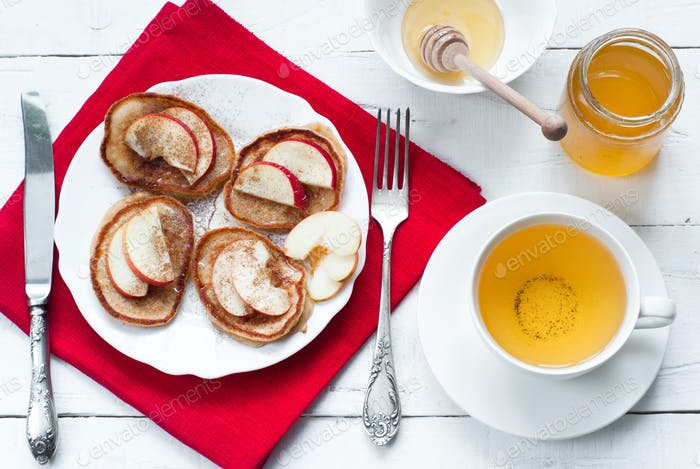 Pancakes with apple, cinnamon and honey.