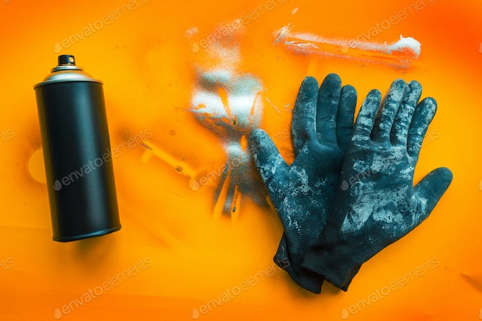 Color spray can and gloves for graffiti artwork
