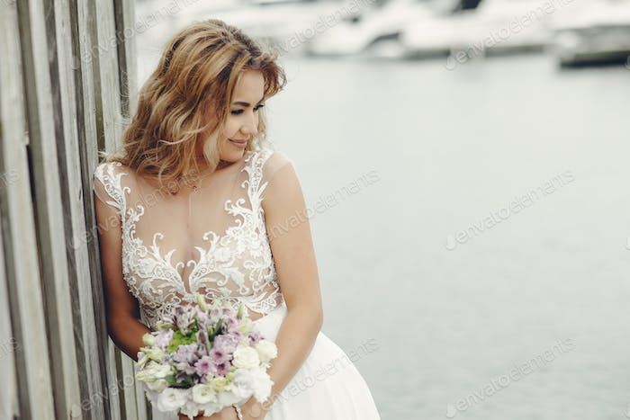 Elegant bride near water