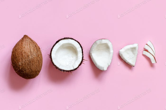 Coconut pieces on a light pink background