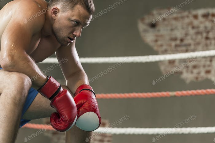 Professional boxer taking rest