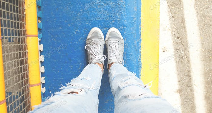 gray hipster sneakers on a bright blue and yellow background