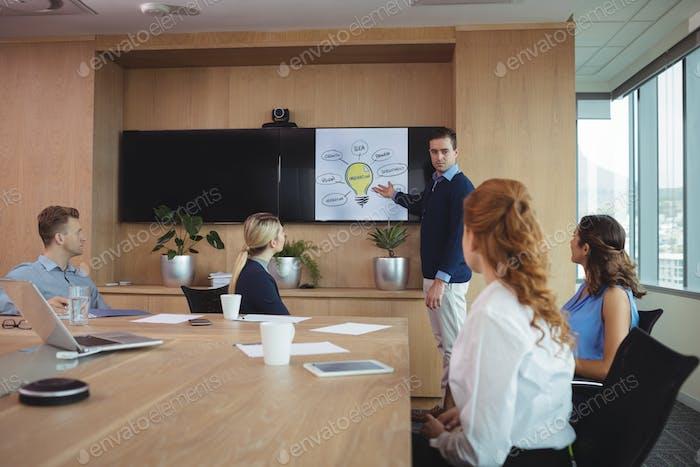Businessman explaining plans to colleagues