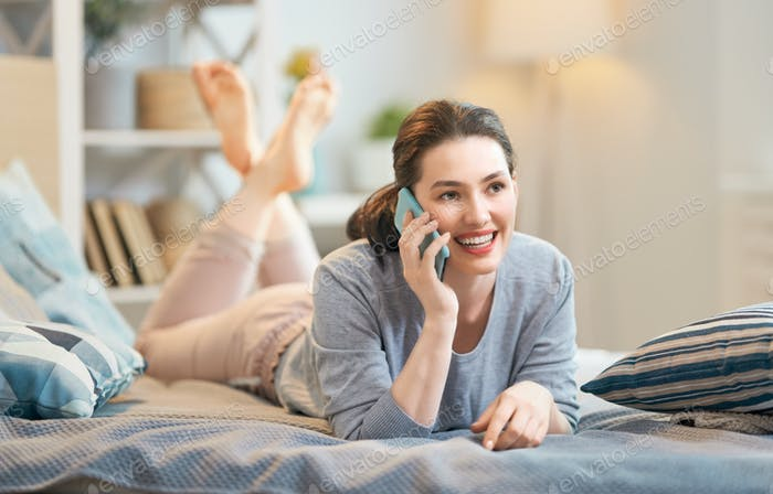 woman is talking on a phone