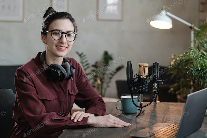 Podcaster sitting in studio