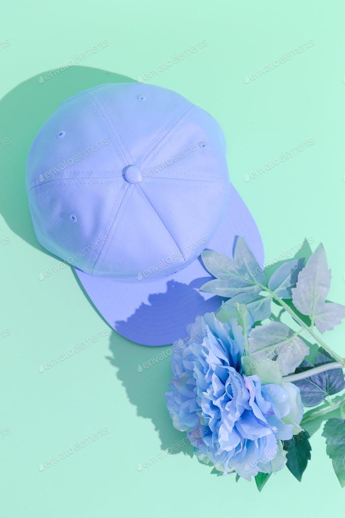 Plastik blue flowers and cap. Minimal design. Fashion accessories concept