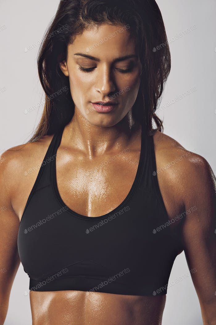 Tanned woman with muscular body