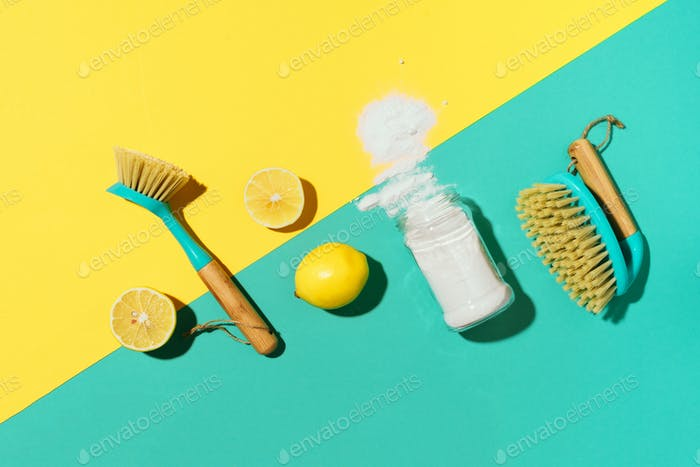Flat lay composition with eco-friendly natural cleaners. Baking soda, salt, lemon, mustard powder