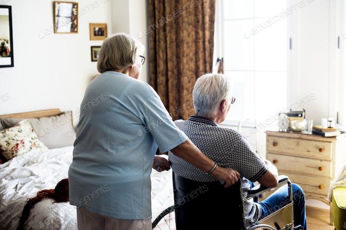 Senior couple taking care together