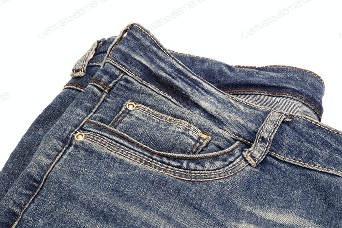 Fragment of dark blue jeans isolated on white
