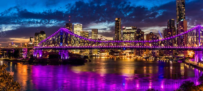 Night time panorama of Brisbane city with Story Bridge