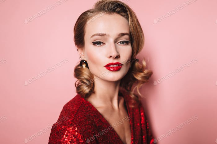 Close up young gorgeous woman with wavy hairstyle and red lips i