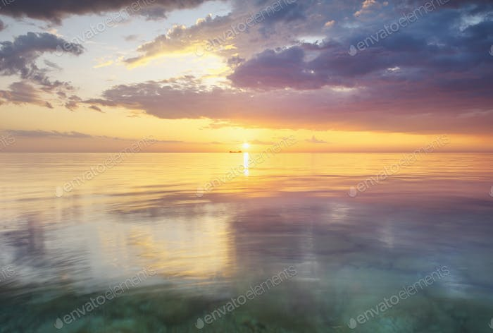Sky background and water reflection on sunset