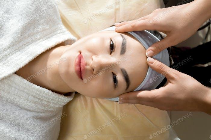 Pretty Asian Woman in Beauty salon