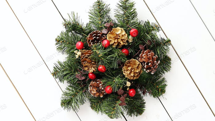 Christmas Wreath on White Wooden Background