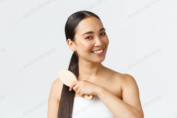 Beauty, Haarausfall Produkte, Shampoo und Haarpflege Konzept. Nahaufnahme von schönen asiatischen weiblich in