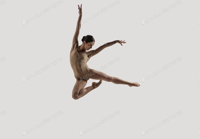 Modern ballet dancer. Contemporary art ballet. Young flexible athletic woman