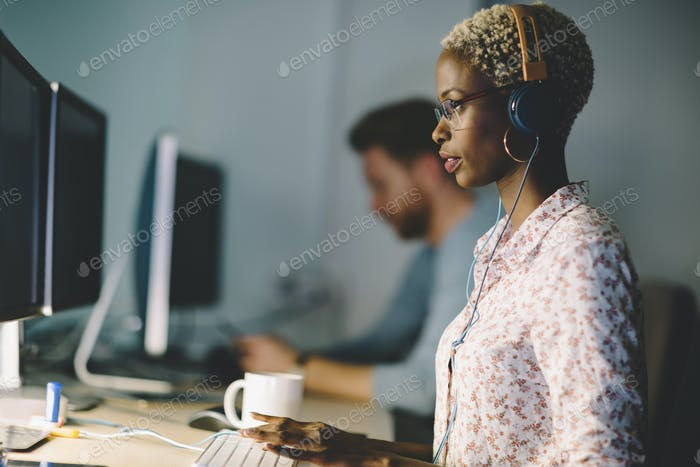 African american woman working on desktop in office