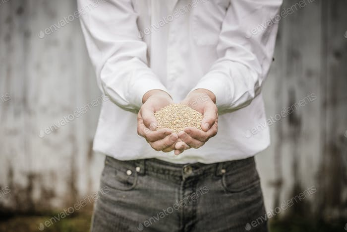 Farmer Showing Animal Dry Food
