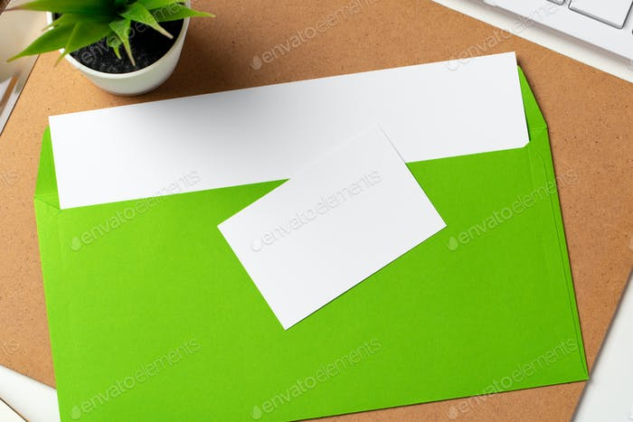 Blank business cards with supplies and keyboard on office table