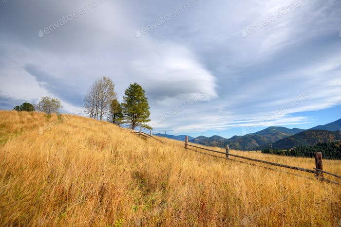 Beautiful autumn landscape in mountains and blue sky with clouds