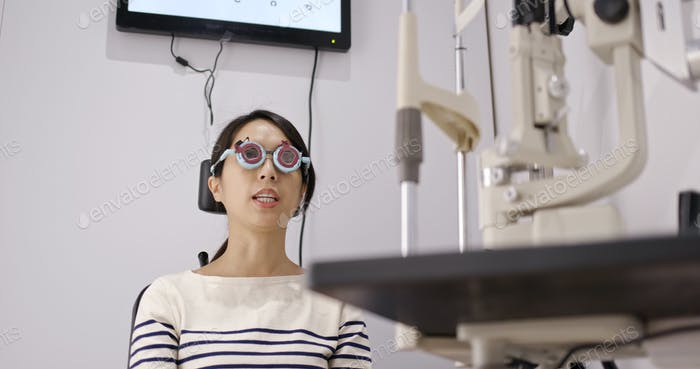 Woman check on eye at clinic