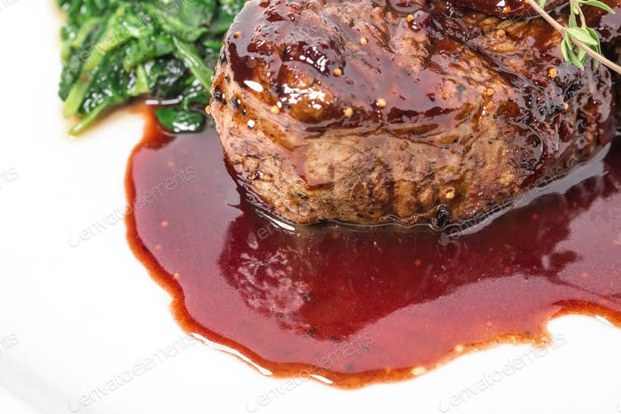 Delicious fillet mignon steak with chard.