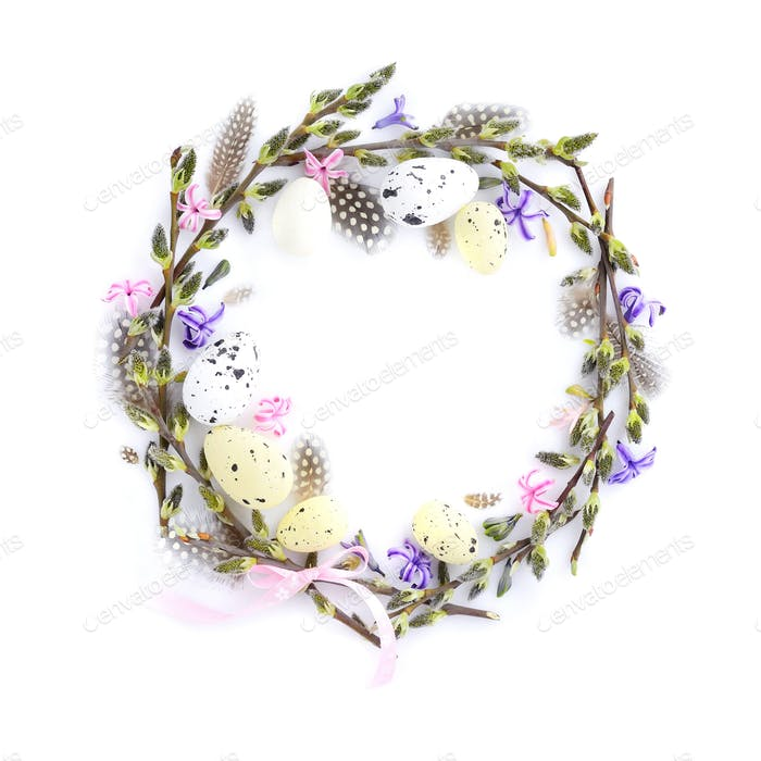 Easter wreath with easter eggs, pussy-willow branches and flower