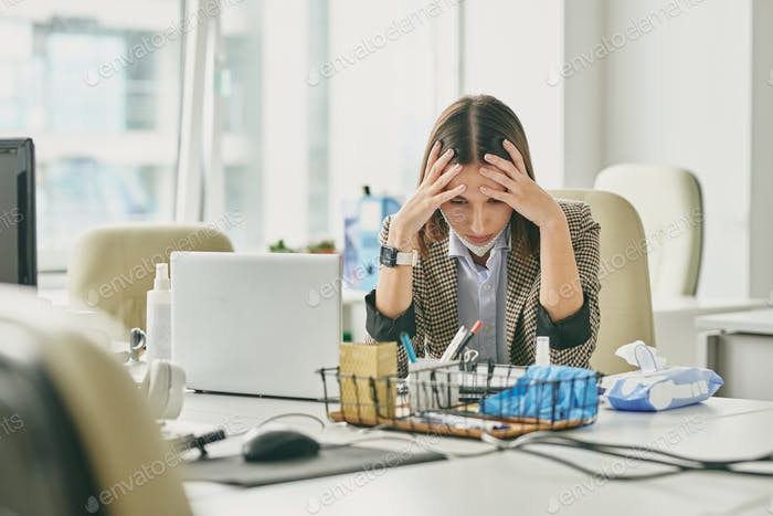 Puzzled woman in empty office during coronavirus epidemic