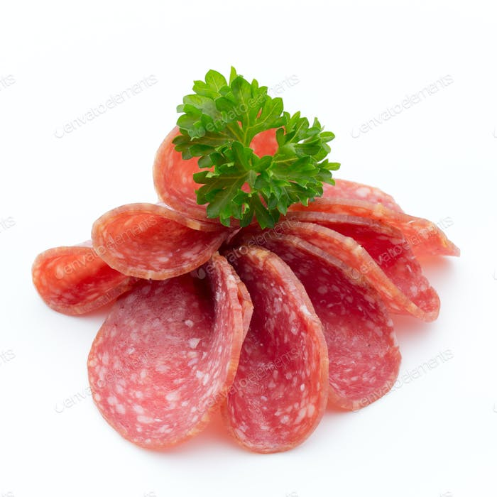 Salami smoked sausages slices isolated on white background.