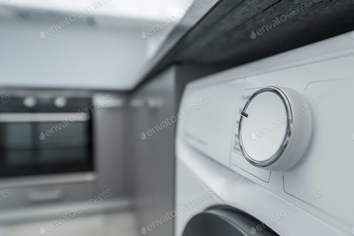 Modern Elegant Washing Machine Inside Apartment Kitchen Space