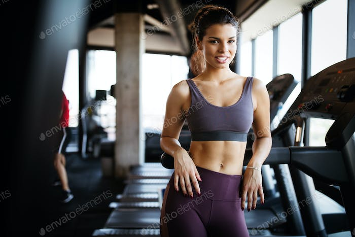 Sport, fitness, lifestyle and people concept. Happy fit people exercising in gym