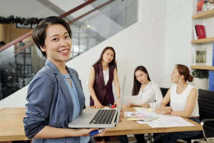 Asian businesswoman with opened laptop