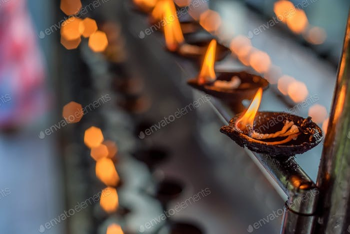 Coconut oil lamps in temple