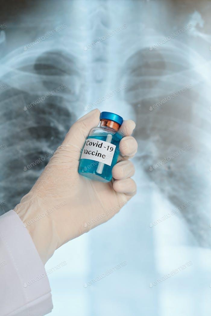 Pulmonologist holding covid-19 vaccine