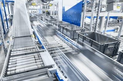 Modern conveyor system with boxes in motion.