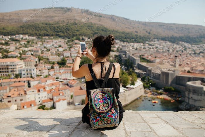 woman travel with smartphone and backpack