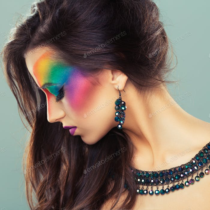 Thumbnail for Portrait of a beautiful girl with a fashion bright multicolored