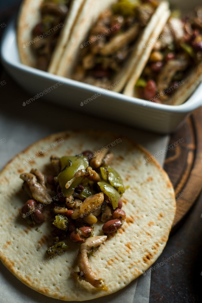Stuffed tortilla pieces of chicken and pepper. Mexican dish side view