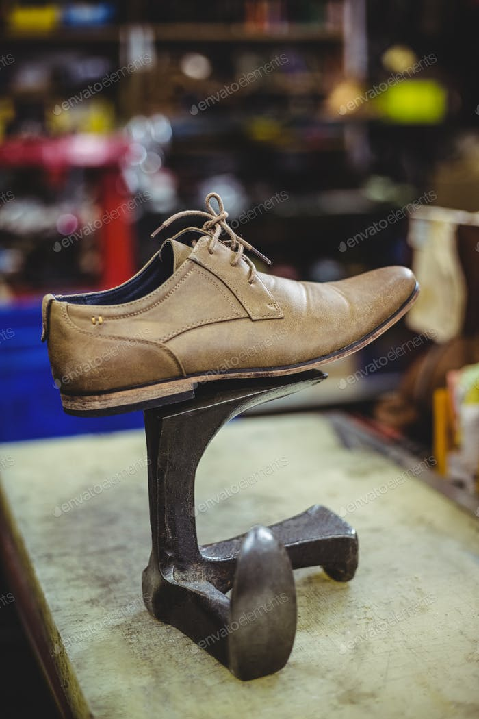 Leather shoe on shoe repair stand