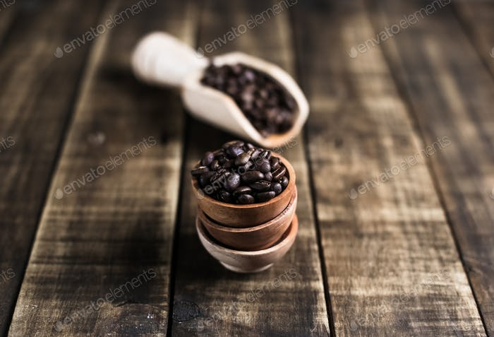 coffee beans with wooden saucer and scoop