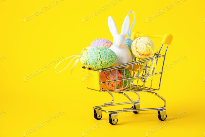 Happy Easter background.Easter eggs colorful in the shopping cart