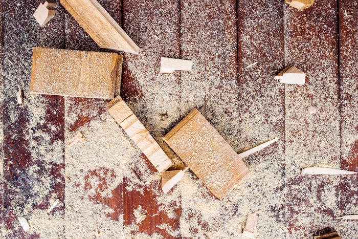 Close up of cutters of wood lying among sawdust