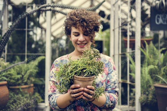 Woman holding a pot of plants