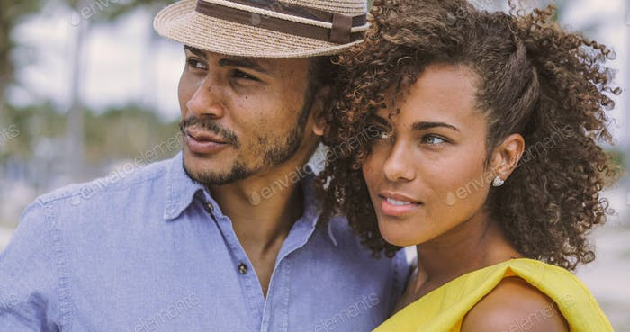 Ethnic couple looking away