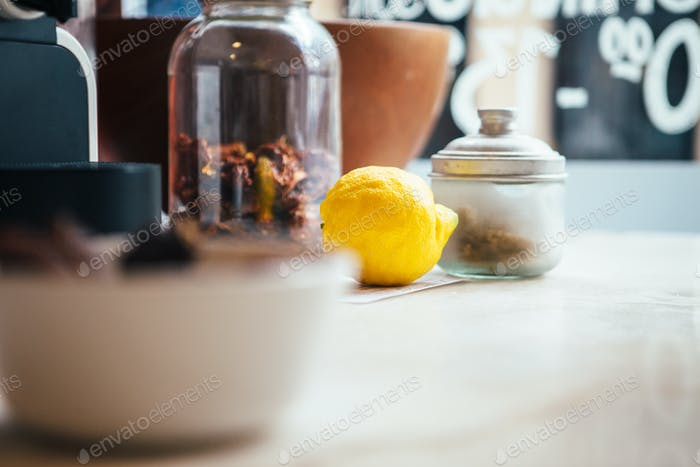 Lemon and spices in containers in daylight